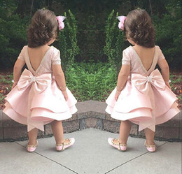 Lovely Puffy Pink Flower Girls Vestidos para boda Satin Ruched Jewel Neckline2015 New First Communion Vestidos para niños Bow Top Quality Short Corto desde fabricantes
