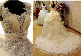 Wholesale pink flowers photos - 2015 New Modest Crystals Wedding Dresses Flowers Beads Sweetheart Backless Bow Falbala A Line Chapel Train Tulle Bling White Bridal Gowns