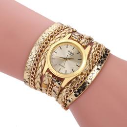 Goldkette armbanduhren online-Frauen-Art- und Weiseleder-Armband-Uhr-Diamant-Niet-Schlangen-Ketten-lange Bügel-Damen-Kleid-kreative zufällige Quarz-Armbanduhren