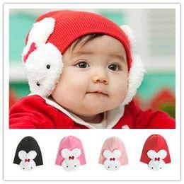 Wholesale Knitting Kids Hats Design - Baby Kids Winter warm hats Earmuffs knitted caps 4 colors kids hat cartoon design crochet Animal hats LA120-1