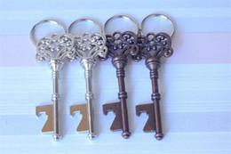 Wholesale Beer Uk - 200pcs HouseHolds chic Novelty Mini UK Suck KeyChain Key Chain Beer Bottle OPENER Bottle Opener D718J