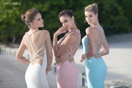 Wholesale Tarik Ediz Blue Dresses - Tarik Ediz Sping Summer 2016 Illusion Mermaid Prom Dresses With Pearls Beaded And Sweep Train Custom Pageant Formal Gown
