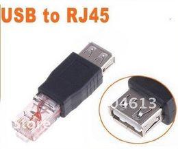Envío gratis 1 pieza hembra USB A macho a Ethernet adaptador de enchufe RJ45 Nuevo desde fabricantes