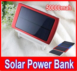 Batería solar portable del teléfono celular online-50000mah Banco de la energía solar Cargador de la batería 50000 mAh Panel solar Puertos de carga dual Banco de la energía portátil para todos los teléfonos celulares PC PC MP3