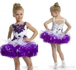 Wholesale Kids Cupcake Dresses - 2016 Custom Glitz Cupcake Girl Pageant Dresses Toddler Spaghetti Neck with Beaded Crystal Purple and White with Bow Kids Prom Ball Gown