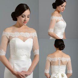 Wholesale Black Bridal Lace Bolero Jacket - 2015 New Design Off Shoulder Half Sleeve Lace Bolero Jacket Cheap Cap Wrap Shrug For Wedding Bridal Evening Party PJ010 Free Shipping