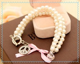Wholesale Pearl Bracelet Peace Sign - Wholesale-Retail and Wholesale Hot Sale New Fashion Imitation inlay antiwar peace sign three-string pearl bracelet female ball jewelry