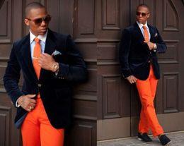 Wholesale Mens Designer Winter Jackets - Black Velvet Tuxedos For Men with Orange Pants Handsome Mens Wedding Tuxedos Designer Mens Suits (Jacket+Pants+Tie)