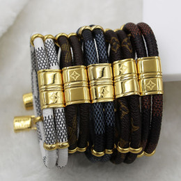 Wholesale Double Leather Charms Bracelet - New fashion Famous brand double small accessories small lock leather bracelet titanium steel buckle leather rope bracelet hot sale