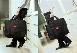 bd9f41ae42f2 2015 Foldable Nylon Suitcase Hand Luggage Cabin Small Wheeled Travel  Folding Flight Bag Large Capacity Case Travel Insert Handbag 100pcs LB4