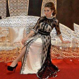 2019 vestido de fiesta de gasa azul brillo 2018 Vestidos de noche de encaje negro con medias mangas con abalorios de cristal Caftan Dubai Arabia Largo vestido largo