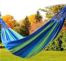 Tela di canapa doppia online-Travel Camping Canvas Hammock Outdoor Swing Garden Indoor Dormire Rainbow Stripe Double Hammock Letto 280X80cm regalo di trasporto di goccia