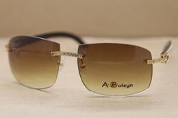 Genuino Cuerno de búfalo natural Blanco interior Negro Gafas de sol sin montura Gran diamante Marca Hombres Gafas Tamaño del marco: 62-18-140mm desde fabricantes