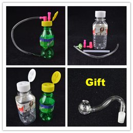 "smoking hose Promo Codes - Mini Plastic Oil Rig Portable Smoking 10mm joint Stoned Spring Water Mineral Water Bottle Shaped 4"" inch with Hose Free Curved Bucket Bowl"