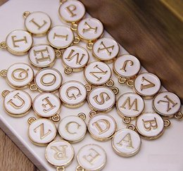 Wholesale Round Disc Charm - 26pcs Letters Stamped Initial Charm Pendants GOLD Plated White Drip on Double Sides 12*15mm Round Disc Letter Alphabe for necklace