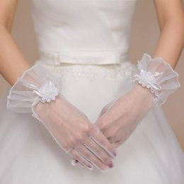 Wholesale White Winter Gloves Wholesale - Sexy Fashion White Lace Wedding Bridal Full Finger Gloves Wrist Length Winters Women With Bows Flower Bridal Wedding Accessories