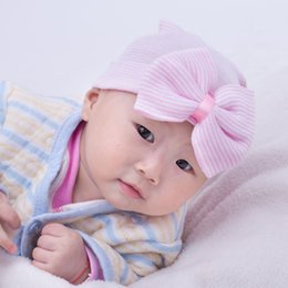 Wholesale White Baby Beanie - New hot babies caps with bowknot cute newborn baby hats Elasticity infant cap kids toddler hat five colors knitting baby warm beanies