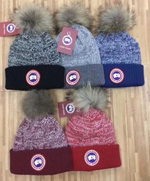 Wholesale Knit Fur Hats Women - Hot Winter unisex brand CA CANADA men knitted hat classical sports skull caps big fur pom-pom women casual outdoor beanies
