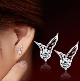 Mujeres de la manera 30% 925 joyería plateada plata hermosa alas del ángel Crystal Ear Stud pendientes ASD compras libres desde fabricantes