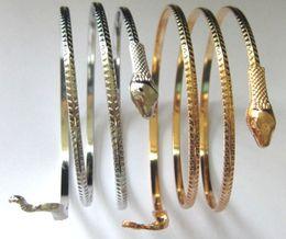 gold oberarm armbänder Rabatt 2015 neue Mode Punk Gold Silber Alloy Coiled Snake Spiral Oberarm Stulpearmband Armband Armbinde Für Männer Frauen JD