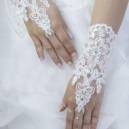 Wholesale Short Fingerless Lace - Elegant White Lace Bridal Gloves Wrist Fingerless Short Paragraph Rhinestone Wedding Gloves Free Shipping Wholesale Hot Sale