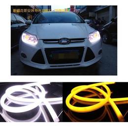 Wholesale Led Headlight Strip - car styling 2X60cm White+Yellow Flexible Headlight Daytime Lamp Switchback Strip Angel Eye DRL Decorative Light With Turn Signal