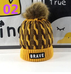 Wholesale Braves Beanie - 50pcs warm children's high-quality hat label BRAVE boys and girls warm winter windproof hat 5-15-year-old flexible ball wholesale