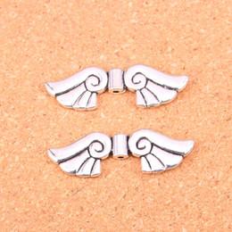 2019 silberne metallflügel 32pcs Antik Silber Charms Engelsflügel Bead Anhänger Fit Armbänder Halskette DIY Metall Schmuck machen 14 * 44 * 5mm rabatt silberne metallflügel