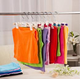 I pantaloni di plastica liberano online-Spedizione gratuita brandnew di buona qualità di plastica di vendite calde brandnew dei vestiti dei pantaloni dei ganci dei pantaloni dei bambini del bambino