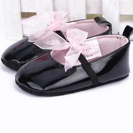 Wholesale Infant Ribbon Shoe Laces - Wholesale- Hot Top Fashion Newborn Infant Crib Ribbon Bowknot Dance Shoes Baby Girls Lace Soft Sole PU Leather Black Prewalker First Walker