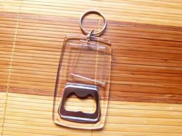 Marco plástico de la foto llaveros personalizados online-ENVÍO GRATIS POR DHL 100pcs / lot Nuevos llaveros de acrílico en blanco plástico con el abrebotellas en blanco Llaveros del marco de fotos para los regalos
