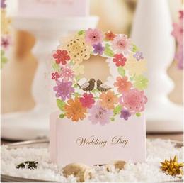 Caixa de corte a laser on-line-100 Pcs estilo Europeu escavar flores de corte A Laser caixas de Casamento Caixa de Doces caixa de presente de casamento bonbonniere favor do casamento caixas THZ175