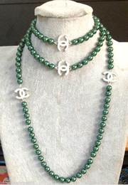grüne jade halskette anhänger Rabatt 2016 heißer kauf perle jade armband ring ohrring halskette Anhänger NEUE Top Lange schöne 8mm Malachitgrün shell perlenkette 50