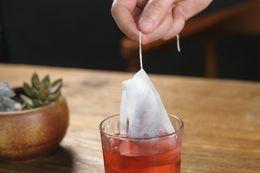 Teefilterbeutel string online-Leere Teebeutel Teebeutel String Heal Seal Filterpapier Teebeutel 5,5 x 7 CM für Kraut Losen Tee