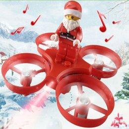 bras de morceau Promotion Mouche Santa Claus Quadcopter Hélicoptère De Noël Jouet Télécommande Avion Avec LED Lumière De Noël Musique Pour Enfants Cadeau