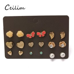 Wholesale Cute Cross Ring - 9 pair set newest korean cute fashion crown stud earrings for young girl flower cross love leaf butterfly stud ear rings