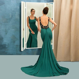 Wholesale long fashionable party dresses - 2017 Fashionable Emerald Satin Evening Dresses Backless Spaghetti Strap With Black Appliques Long Evening Party Long Green Prom Gowns