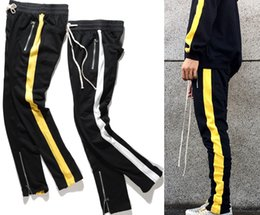 Wholesale Stripe Pants Top - 2017 NEW TOP kanye west white yellow splice stripes men pants hip hop pocket foot trousers Side zipper Casual sports pants 2 color M-XXL