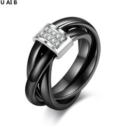 Wholesale South Korean Fashion - Korean version of the three-ring tightly wound ceramic simulated diamond fashion love rings for women anillos free shipping