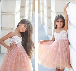 Vestido de cumpleaños 12 talla online-2016 Champagne Girls Vestidos del desfile Tulle Cuello de perla con cuentas Hasta la rodilla Princesa Tamaño 13 Partido Niños Cumpleaños Vestidos de niña de flores