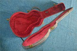 Directo de guitarra eléctrica HARDCASE más vendido de China, forro rojo de cuero negro, hebilla de latón desde fabricantes
