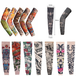 Wholesale Fake Tattoo Arm Sleeve - 2016 Unisex Nylon Elastic Fake Tattoo Sleeves Designs Anti UV Arm Stockings Tattoo Wears Driving Sleeves Mix 108 Styles Free DHL L4