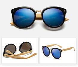 Wholesale beach sellers - Wholesale hot seller Bamboo+plastic sunglassesfor men and women brand designer 2016 bamboo sunglasses cycling glasses UV400 CE protection