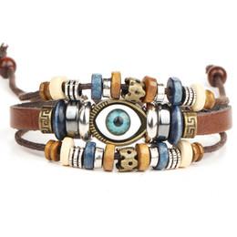 Armband leder ketten online-Ethnische Woven Lederarmband Bnagles Evil Eye Perlen Warp Armband Charms Vintage-Schmuck für Frauen Männer Multilayer verstellbare Armband