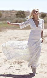 UK wedding dress line sheath - 2016 Boho Wedding Dress With V-neck A-Line Lace Floor Length Half Sleeves Bohemian 1970s Wedding Gowns #DL10171