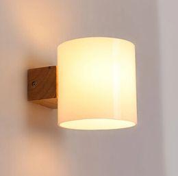 Простой современный твердой древесины бра светодиодные настенные светильники для дома Спальня прикроватные настенные лампы внутреннего освещения Lamparas по сравнению cheap modern lamp wood от Поставщики современная лампа