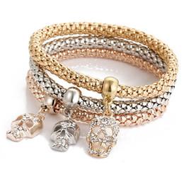roségold schädel armband Rabatt Europäische Armband Kristallschädel Rund Anhänger Armband Gold Rose Gold Silber 3 teile / satz für Frauen Stretch Popcorn Armbänder Großhandel