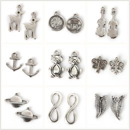 Wholesale Violins Charms - Hot Selling Fine 650pcs bag Electroplate Silver Color Butterfly Leaves Tiger Earth Violin Pendants For Women Girls Jewelry Accessories Gift