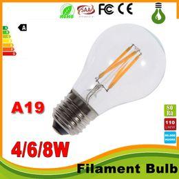 Globo led lâmpada a19 on-line-Luzes led Regulável 4W 6W 8W E27 Branco quente Branco fresco A60 A19 Lâmpada LED de filamento do vintage 85-265V AC Regulável Edison Globe Bulb