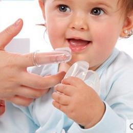 Argentina Cepillo de dientes suave para la limpieza Dientes de bebé Gomas Silicona Dedo Cepillo de dientes Dientes de niños Masaje claro Yema de dedos cheap massages toothbrush Suministro